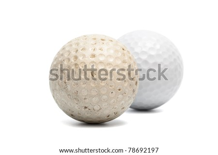 old and new golf ball on a white background - stock photo
