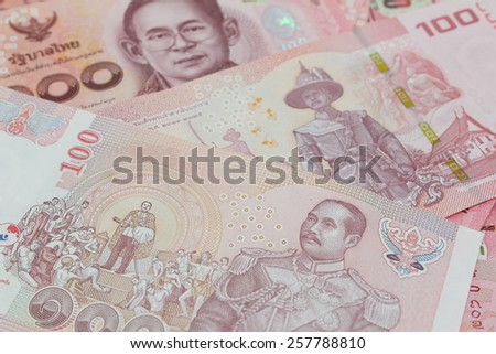 Old and New versions of hundred Thai bank notes  - stock photo
