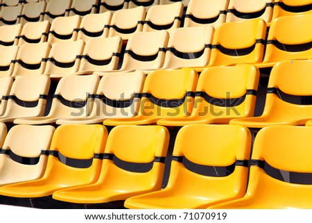 old and new yellow seat in stadium - stock photo