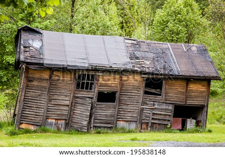 Old and run-down rustic barn - stock photo