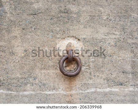 old and rust chain link attached to a concrete wall - stock photo