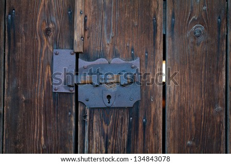old and rustic door lock - stock photo
