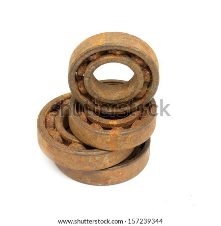 Old and rusty ball bearing, isolated on white background - stock photo