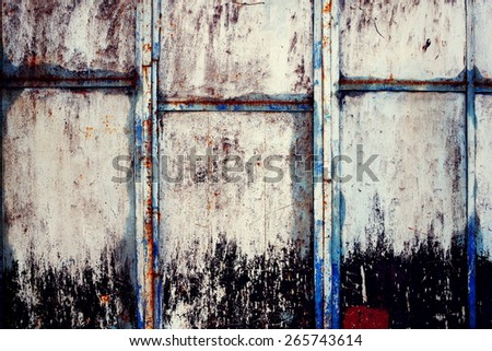 old and rusty metal background with shabby old paint - stock photo