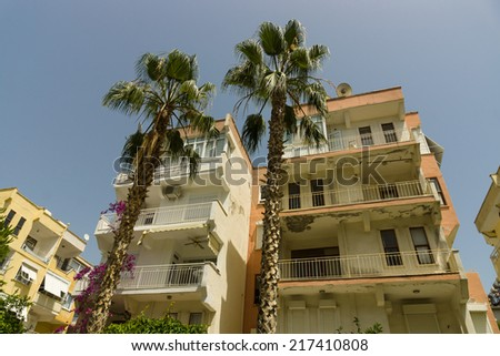 Old and shabby typical apartment building in Alanya. Turkey.  - stock photo