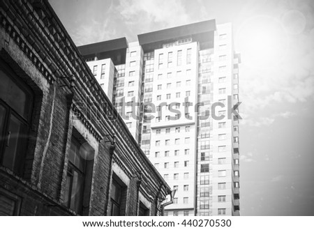 old and the new house, conceptual contrast - stock photo