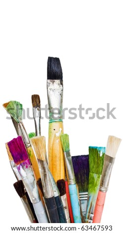 Old and used colorful paintbrushes - stock photo