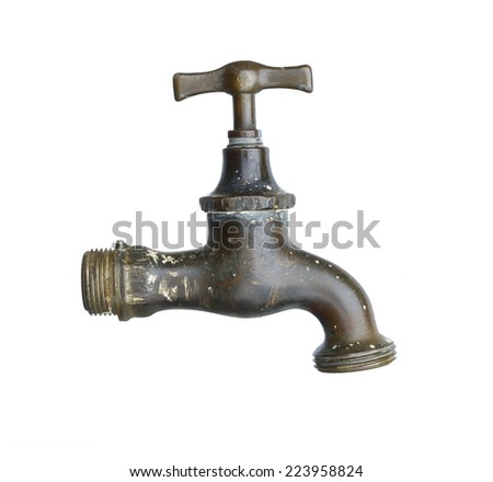 old and used faucet - stock photo