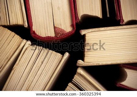 Old and used hardback books - stock photo
