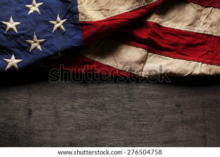 Old and worn American flag for Memorial Day or 4th of July - stock photo