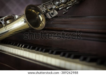 Old and worn Jazz saxophone and piano musical background - stock photo