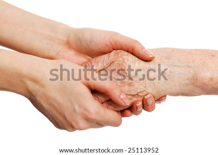 old and young hands; offering comfort - stock photo