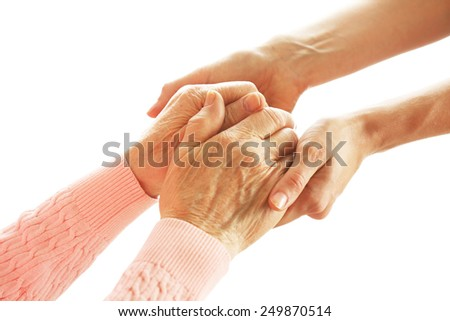 Old and young holding hands, isolated on white - stock photo