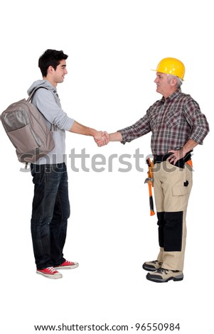 Old and young student worker shaking hands - stock photo