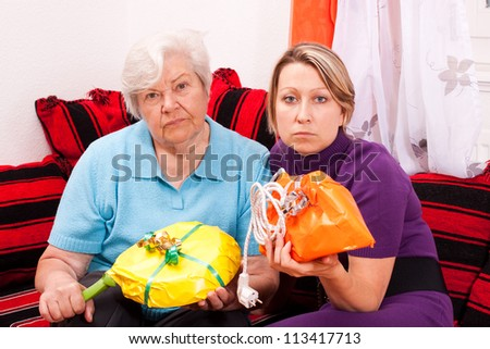 old and young woman are getting improper gifts