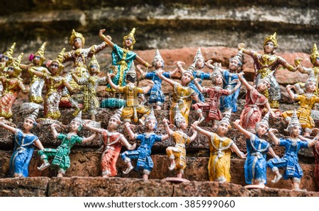 Old angel doll in thai traditional in temple - stock photo