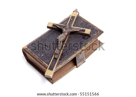 Old antique bible and cross on a white background. - stock photo