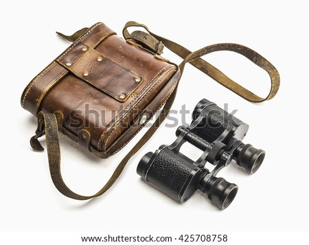 Old antique binoculars and its brown leather bag cover isolated over white background