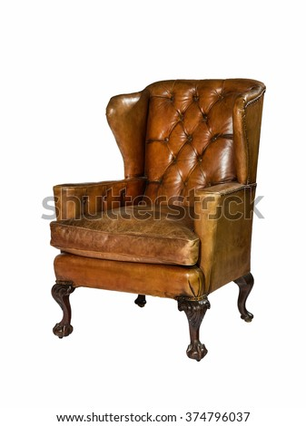 Old antique brown leather wing arm chair isolated with clip path