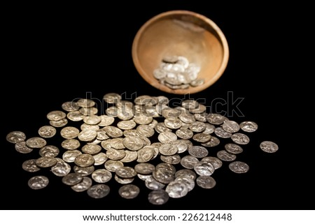 Old antique brown treasure pot with ancient gold and silver coins money black isolated - stock photo