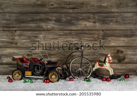 Old antique children toys of wood and tin for christmas decoration on wooden rustic background. - stock photo