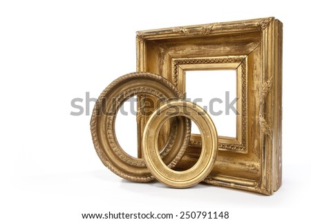 Old antique collection of frames isolated on white - stock photo