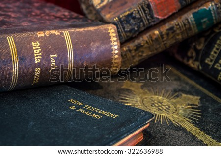 Old antique gilded leather bind Bibles Holy Scripture New Testament and psalms and other books - stock photo