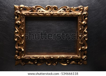 old antique gold wooden frame on grey metal background