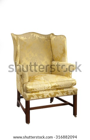 old antique upholstered in yellow material wing arm chair eighteenth to nineteenth century isolated on white