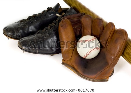 Old, antique, vintage baseball items including a baseball glove, baseball shoes or cleats and a baseball bat