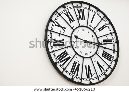 Old antique wall clock on white background