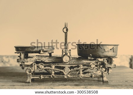 Old Antique weight measuring and kitchen goods weighing on the wooden table - stock photo