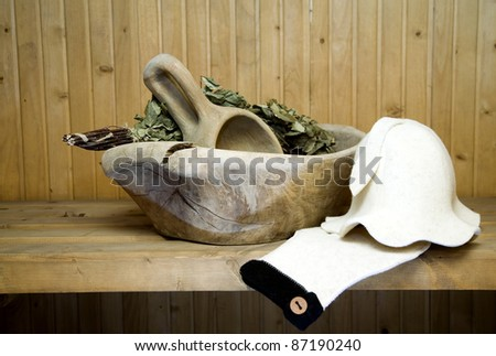 Old antique wooden bowl with spoon for use in bathhouse