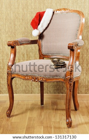 Old Antiques Armchair With Santa's Hat And Book