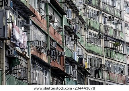 Old apartments in Hong Kong at day  - stock photo