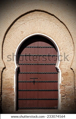 Old arabian door in Marrakesh city, Morocco - stock photo