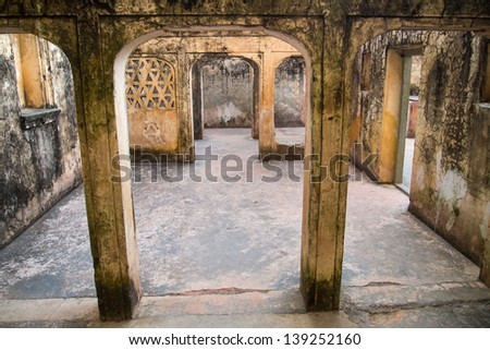 Old arc in palace of the Amber Fort near Jaipur, Rajasthan, India - stock photo