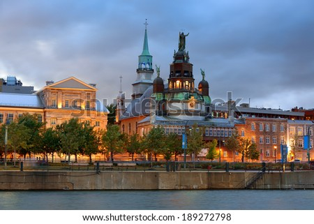 Old architecture at dusk on street in Old Montreal in Canada - stock photo