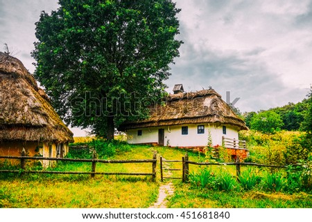 Old architecture of Ukraine. Traditional house with thatch. HDR retouched photo