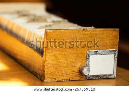 Old archive with wooden drawer in a library - stock photo