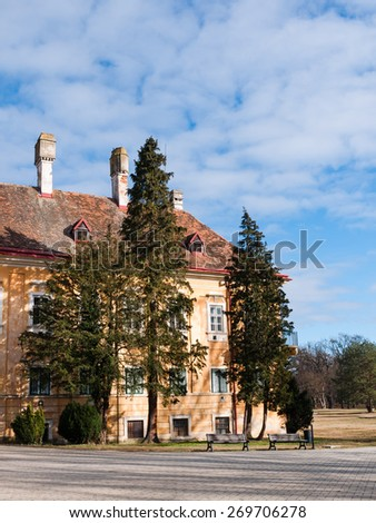 Old aristocratic residence in a park with coniferous trees