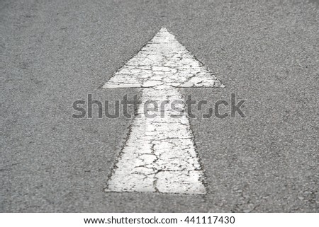Old arrow direction on road
