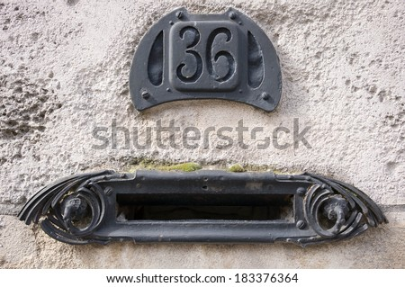 Old Art nouveau style mailbox, Amiens, France - stock photo