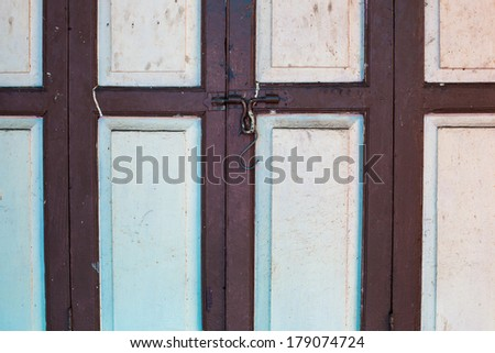 Old Asian hinged door with lock. Background