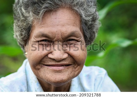 old asian woman smiling.