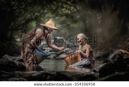Old Asian woman working in cascade - stock photo