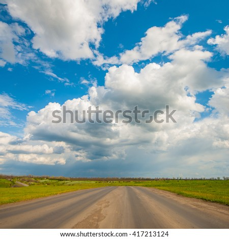 Old asphalt road in the countryside, spring landscape