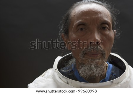 Old astronaut without his helmet