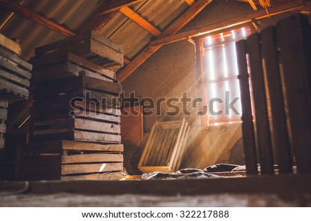 old attic of a house, hidden secrets - stock photo