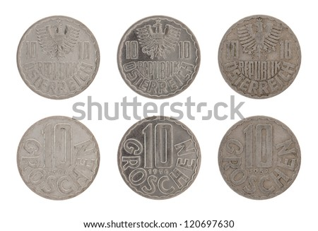 Old Austrian ten groschen coins isolated on white